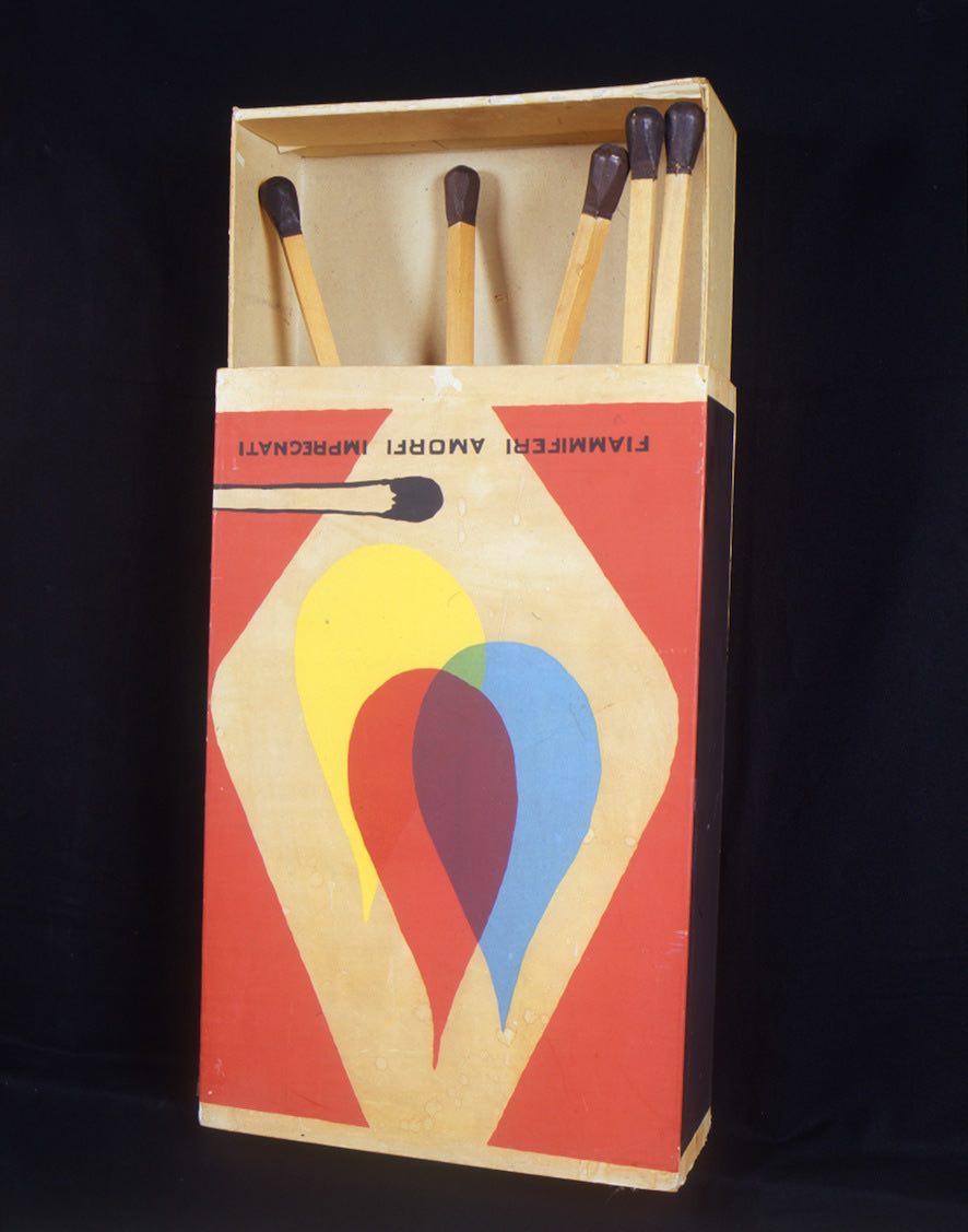 """Saffa (Omaggio a Mondrian e De Chirico), 1970 Scatola in cartone fasciato con carta stampata in litografia e cinque fiammiferi in legno, gesso e resina, 105x50,5x19,5 cm firmata, titolata e datata sotto la base """"Saffa, 1970, Omaggio a Mondrian e a De Chirico, Raymond Hains"""""""